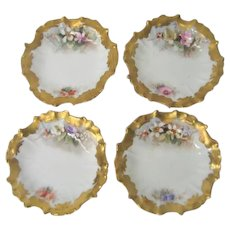 Four Stunning Hand Painted Limoges Floral Butter pats
