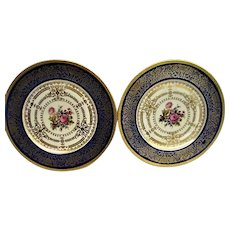 Two Heinrich Blue and Gold with Floral Center Plates