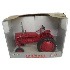 Red Farmall Super-AV Toy Tractor in its original box