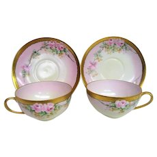 Two Hand Painted Rose Porcelain Cups and Saucers