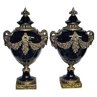 Pair Porcelain Cobalt Neoclassical Footed Ormolu Urns