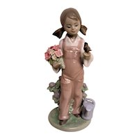 Lladro Young Girl Figurine With Bird Perched on Hand and Flowers