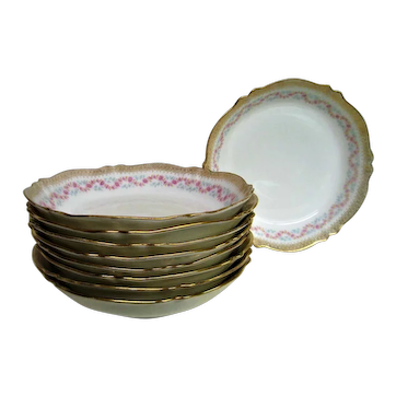 Eight Theodore Haviland Pink Floral Gold Trim Porcelain Bowls