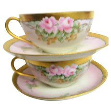 Two Hand Painted Rose Decorated Cups and Saucers