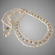 14k Gold Fresh water Pearl Triple Strand Necklace Gold Beads & Clasp