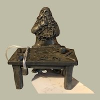 Figural Santa at his work bench, fine Pewter, small figures