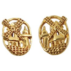 Guy Laroche Paris signed Clip on Earrings vintage goldtone windmill carved design