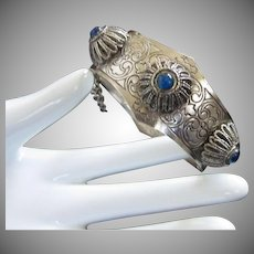 Etched Silver Tone Bracelet with Raised Designs and Peacock Blue Cabs