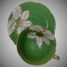 Occupied Japan Green with White Flowers Cup and Saucer
