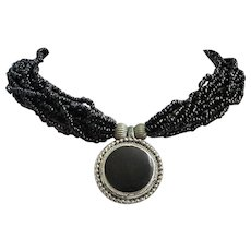 Black Seed Bead Torsade Necklace with Black & Silver Tone Centerpiece