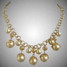 Creamy Charms and Gold Tone Filigree Vintage Necklace