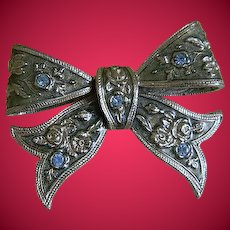 Vintage Silver Tone Bow Brooch with Light Blue Rhinestones
