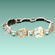 Silver and Turquoise Link Bracelet with Petroglyph Designs