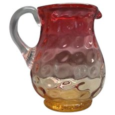 Inverted Thumbprint Amberina Glass Pitcher with Applied Handle