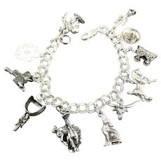 Heavy Southwestern Sterling Silver Charm Bracelet