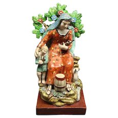 Staffordshire Creamware Figurine Woman & Child Gathering Sticks With Bocage