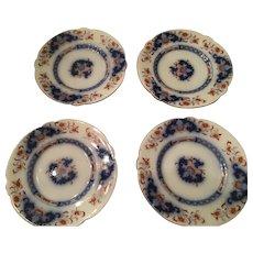 Flow Blue plate with dark orange design