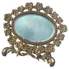 Antique Floral Gilt Metal Beveled Vanity Mirror