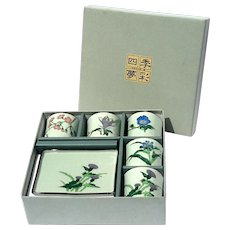 Boxed Japanese Set Of Five Floral Pottery Tea Cups And Trays