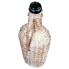 Antique Glass Wine Bottle In Basket