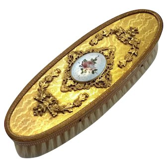 Gilt Metal Vanity Clothes Brush With Enameled Medallion