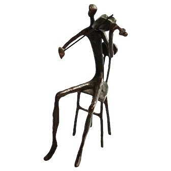 Bronze Statue Of A Seated Figure Playing The Violin