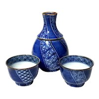 Japanese Porcelain Sake Bottle And Cups