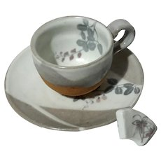 Japanese Stoneware Cup And Saucer