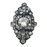 Circa 1900 Silver topped 18kt Yellow gold ring featuring a 1.18 carat weight Old European Cut Diamond
