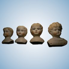 Four Parian Type Doll Heads, one W/Molded Bodice