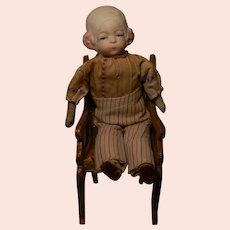Unusual Molded Bonnet Bisque Head Little Doll