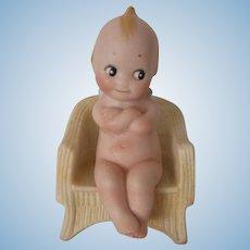"""German Bisque 3 3/4"""" Kewpie Sitting on Chair"""