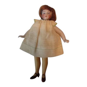 "Antique All Bisque 4 1/2"" Mignonette doll with Gold Stockings"