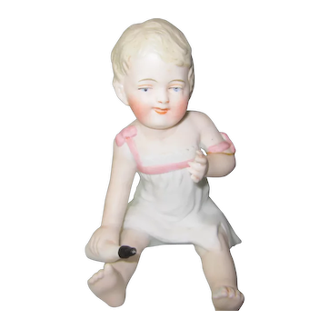 German All Bisque Figurine of Baby with Bottle