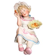 Antique Porcelain Figurine of Girl with Cookies