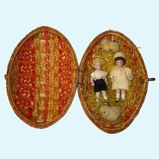 Antique All Bisque Dolls in Wicker Egg