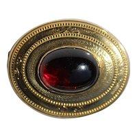 Victorian 9kt gold brooch with garnet cabochon