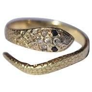 Vintage 18kt snake ring set with diamonds and sapphires