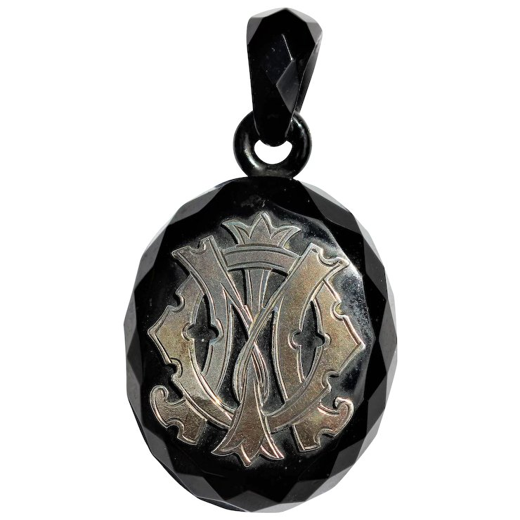 Victorian whitby jet pendant with silver mounted initials navette victorian whitby jet pendant with silver mounted initials aloadofball Images