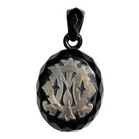Victorian Whitby jet pendant with silver mounted initials