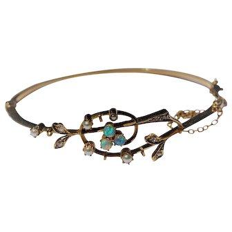 Edwardian opal, diamond and seed pearl 15kt bangle