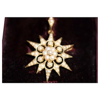 Antique seed pearl starburst pendant/brooch, boxed
