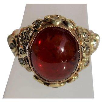 Vintage garnet and diamond ring, set in 14kt gold.