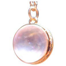 Antique rock crystal locket pendant with 18kt frame
