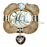 Victorian 14kt mourning hair worked brooch with enamel locket