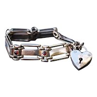 Heavy Victorian 9kt gate link bracelet, with heart padlock and garnets, weight 39 grams