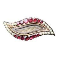 Georgian sentimental eye-shaped brooch, with half pearls and garnets