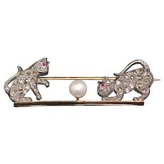 Late Victorian diamond kitten gold and silver bar brooch, with rubies and a cultured pearl