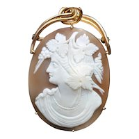 Large antique shell cameo pendant/brooch in a 15k gold frame