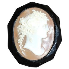 Victorian Whitby jet and shell cameo brooch